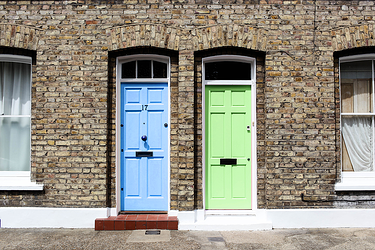 uk-housing-two-doors-blue-and-green-background